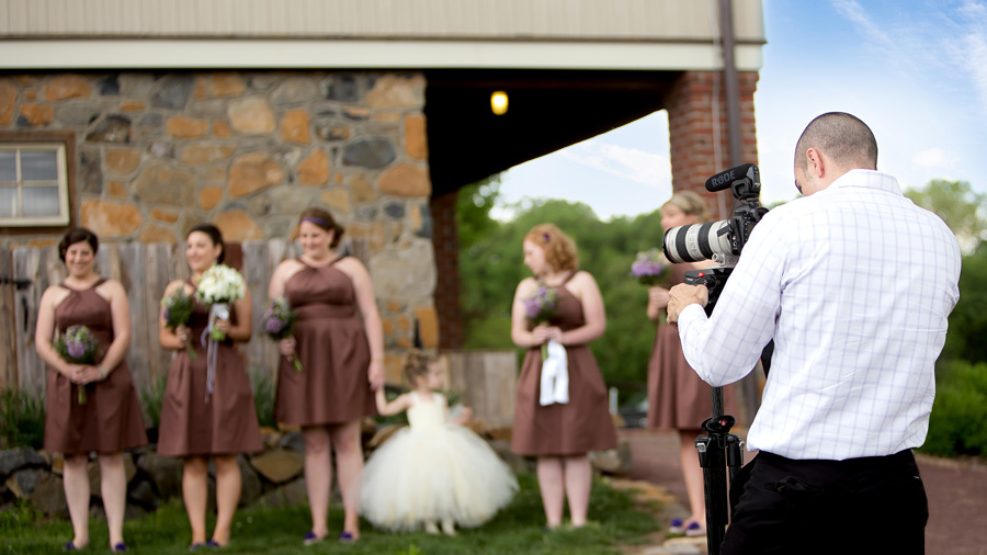 Jarrett behind camera with wedding party